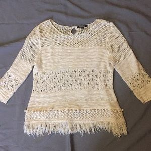 A relatively cream and gold sweater